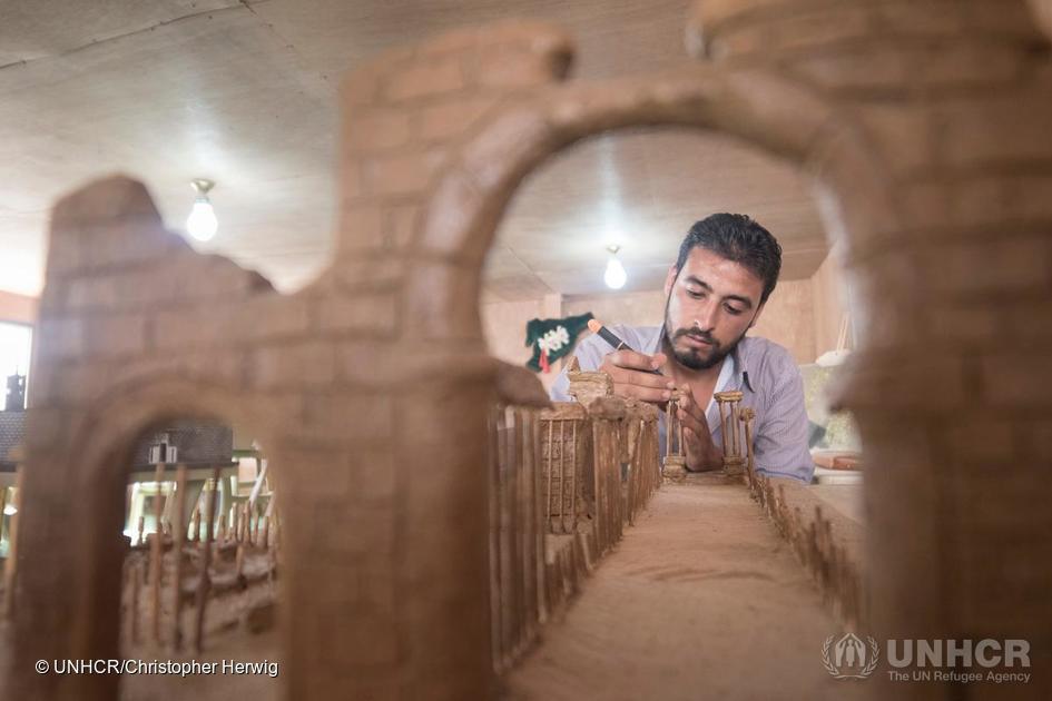 Mahmoud Hariri recreates a model of Palmyra using clay and wooden kebab skewers. Photo: Christopher Herwig.
