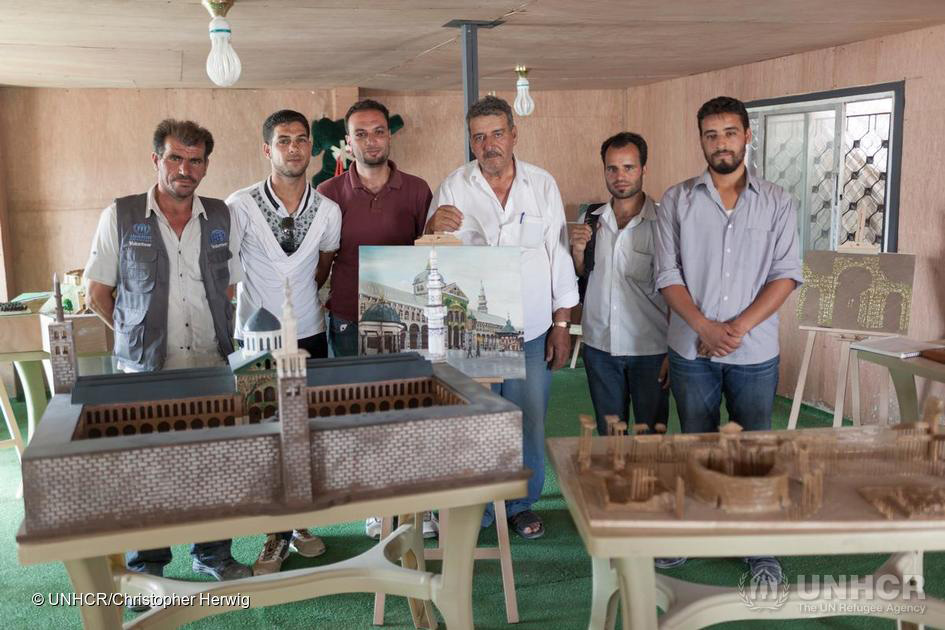 Artists in the Za'atari refugee camp in Jordan team up to recreate important historical monuments in their home Syria. Photo: Chris Herwig